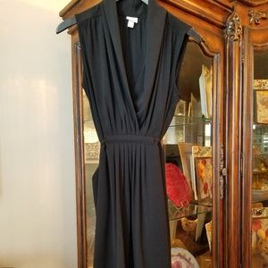 Black dress with pockets and built in tie belt.